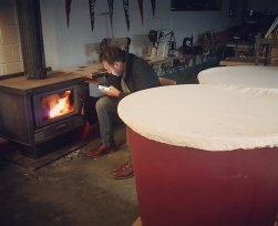 Jess getting the fire going to keep the fermentation happy